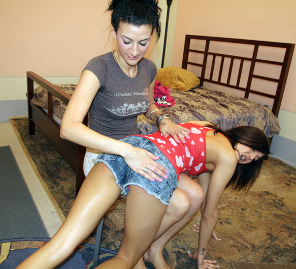 Sadie Holmes get a sound spanking from Riley