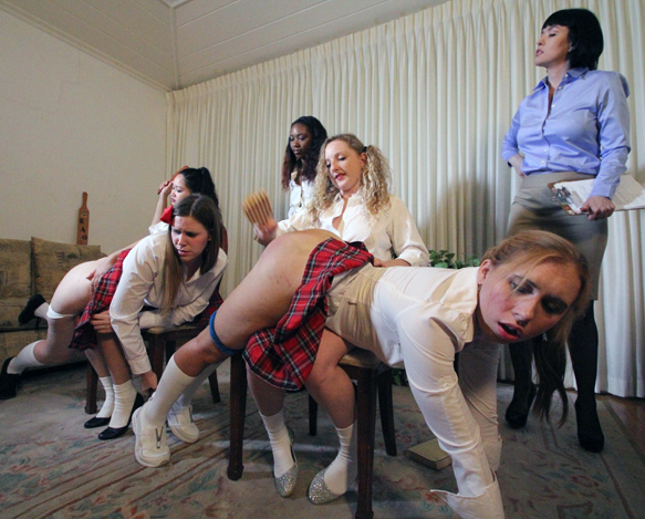 Teacher Snow Mercy supervises the spankings