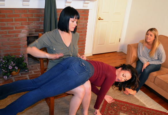 Emily gets spanked on her jeans first.