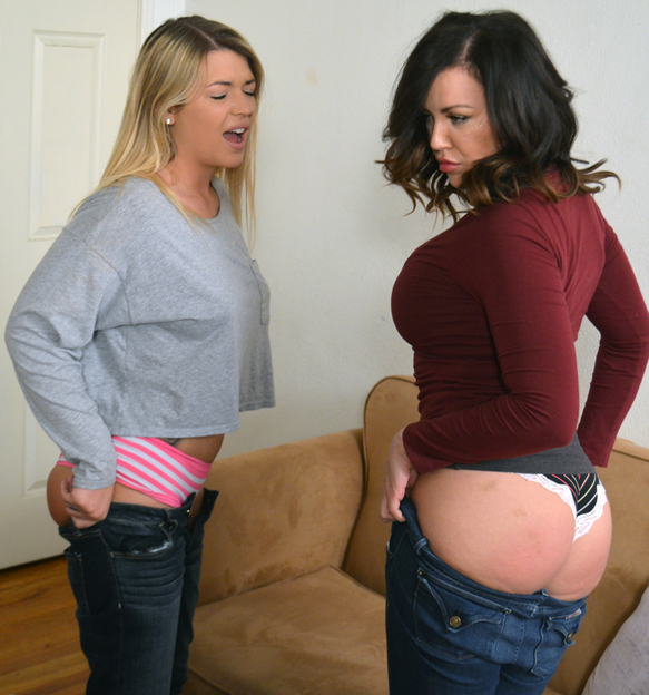 Tight jeans pulled up over freshly spanked bums