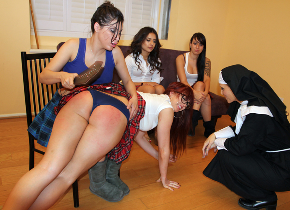 Sometimes Veronica can't help but crack up during a shoot, even when getting spanked