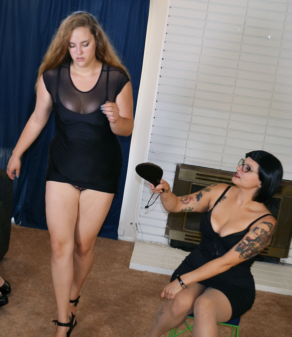 Bettie Bondage teaches Bunny how to walk like a call girl. Success Bettie!