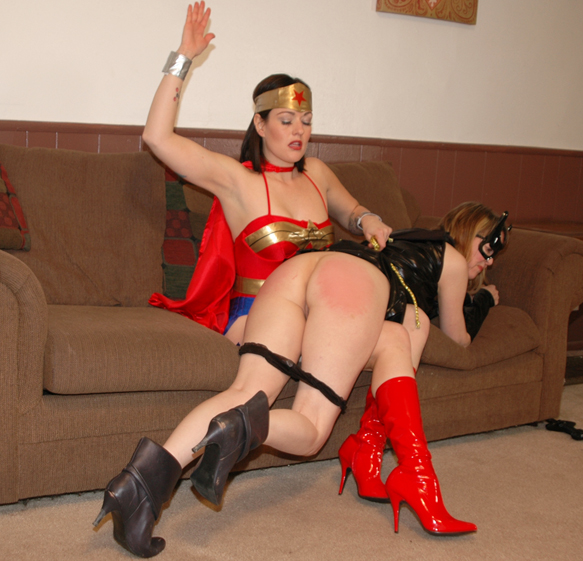 Wonder Woman (Snow Mercy) spanks Batgirl (Clare)