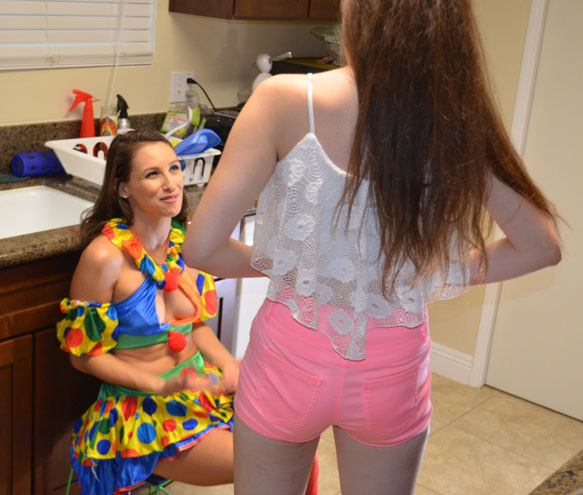 Celeste helps Jamie feel comfortable on her first spanking shoot
